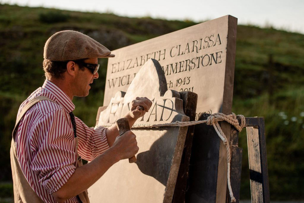 Gabriel carving in his outdoor workshop - photo by C Baker