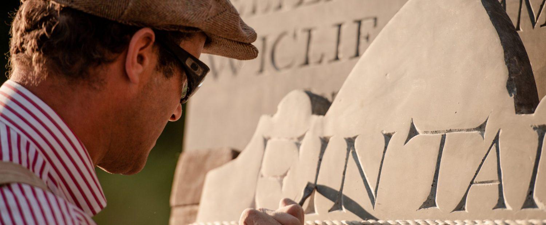 Stone mason carving gravestone